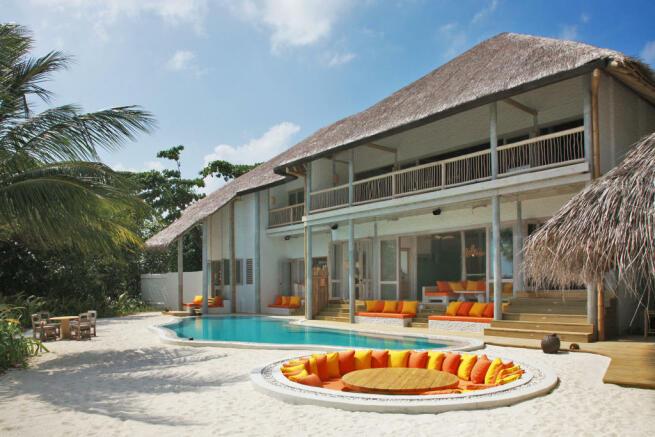 Rear facade sunken dining area outdoor Villa Sunrise at Soneva Fushi Maldives