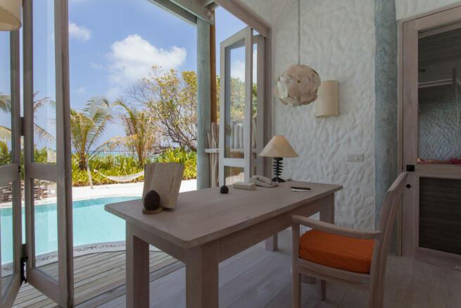 Office french sliding doors swimming pool Villa Sunrise at Soneva Fushi Maldives