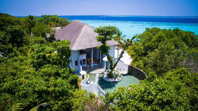 Aerial swimming pool rear facade Villa Sunrise at Soneva Fushi Maldives