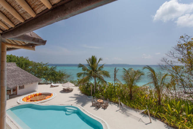 Rear view swimming pool ocean sea Villa Sunrise at Soneva Fushi Maldives