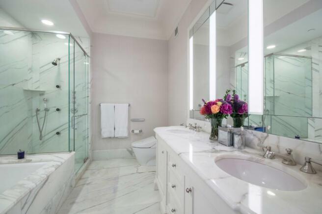 Bathroom twin sink bath tub shower marble stone floor Central Park West New York