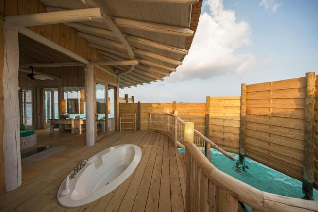 I bedroom over water villa outdoor shower area at Soneva Jani
