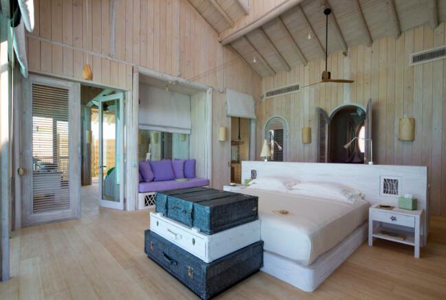 Master bedroom in over water villa at Soneva Jani