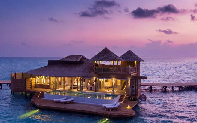 1 bedroom overwater villa exterior at night at Soneva Jani