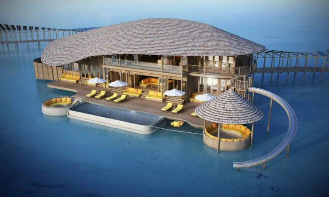 Facade water aerial villa slide swimming pool ocean Soneva Jani Maldives