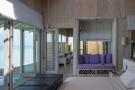 1 bedroom overwater villa master bedroom at Soneva Jani