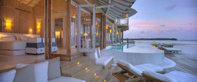 Indoor outdoor living area with pool at Soneva Jani