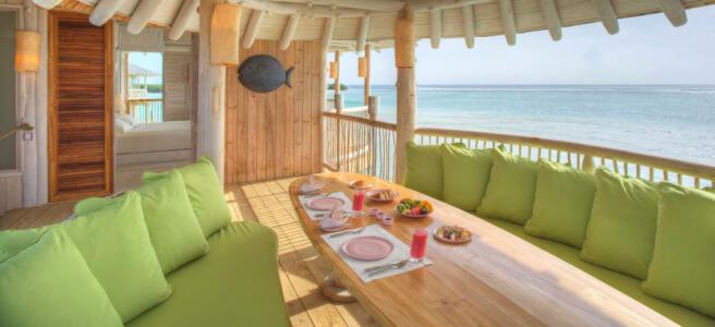 In villa dining in over water villa at Soneva Jani