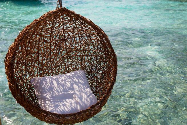 Over water villa swing pod at Soneva Jani