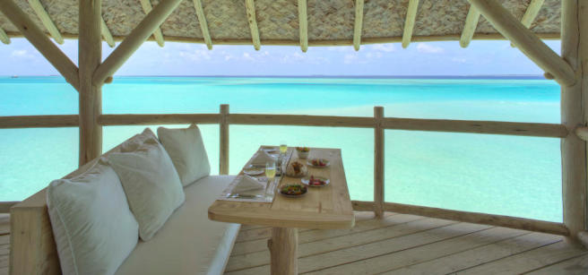 Dining area with sea view in over water villa at Soneva Jani