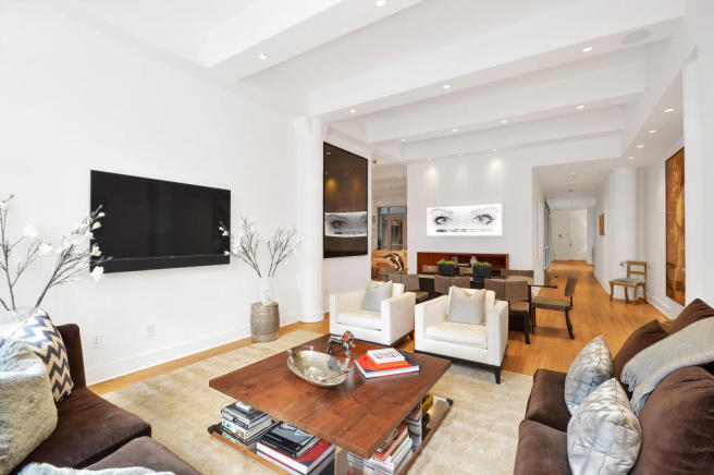 Living room dining wood floor open plan Greenwich Street Apartment New York