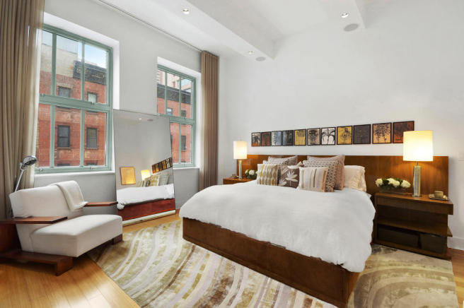Bedroom master wood floor high ceiling Greenwich Street Apartment New York