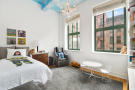 Bedroom wood floor high ceiling Greenwich Street Apartment New York