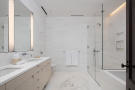 Bathroom twin sink marble shower bath tub West 24th Street New York