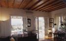 Living room french doords exposed wood beams Ftelia Mykonos