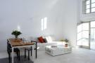 Living room dining stone floor white Villa Fabrica Santorini