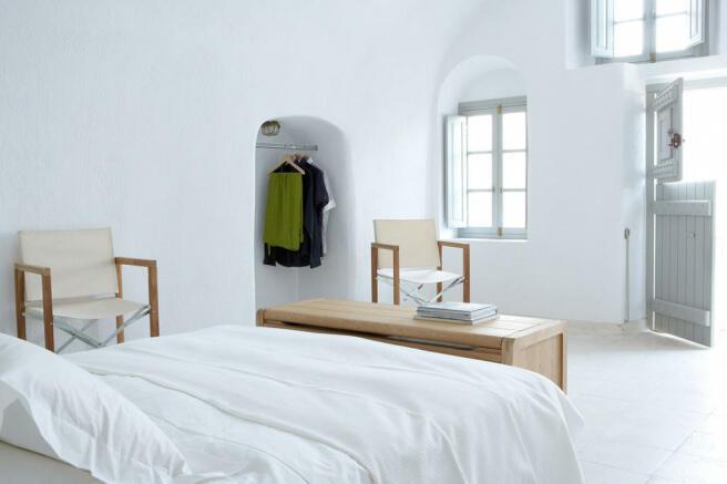 Bedroom split door master white Villa Fabrica Santorini