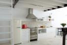 Kitchen white tiled Villa Fabrica Santorini