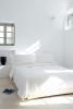 Bedroom white stone floor Villa Fabrica Santorini