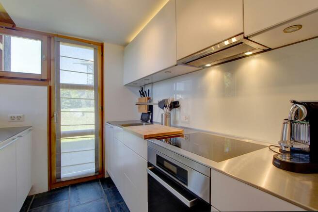 Sleek and modern white kitchen at Chalet Lievre in Verbier