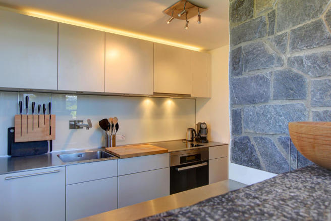 Modern fully fitted white kitchen at Chalet Lievre in Verbier