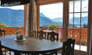 Dining room with mountain views at Chalet Alina