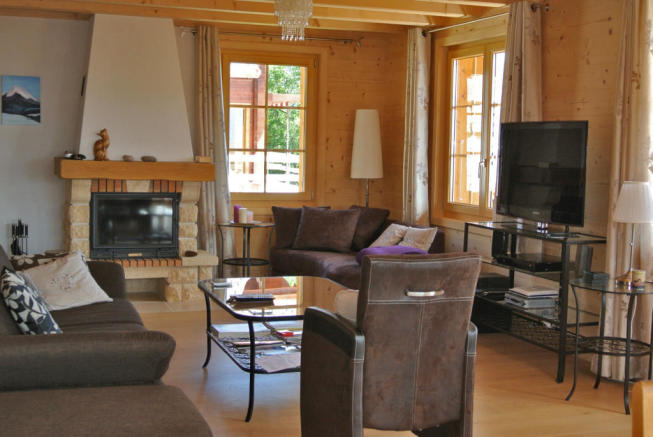 Sitting room with fireplace at Chalet Alina