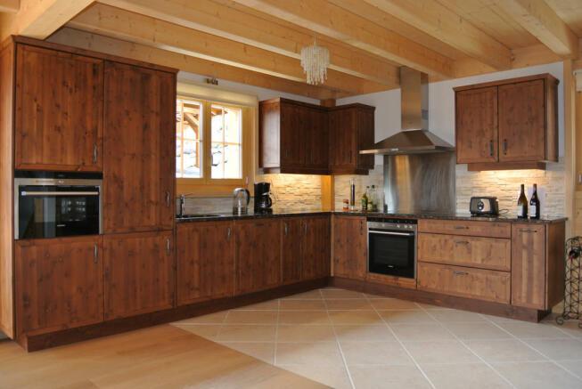 Large wooden kitchen at Chalet Alina