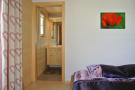 Guest bedroom with en suite bathroom at Chalet Alina
