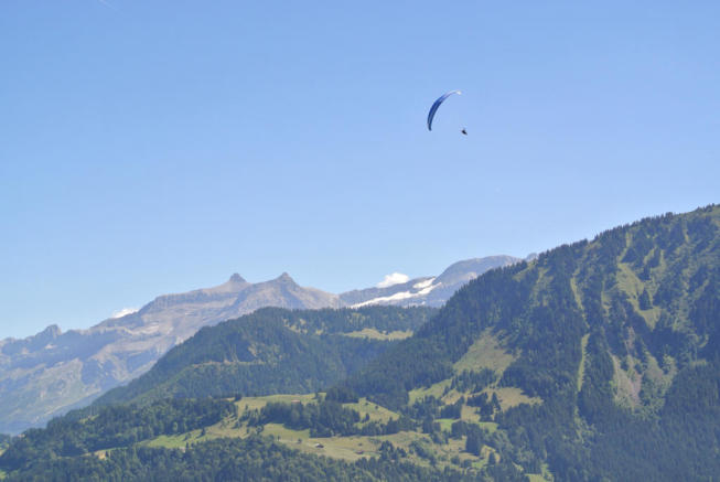 Paragliding over mountains opposite Chalet Alina
