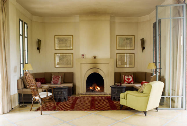 Sitting room with fireplace at Villa Jardin