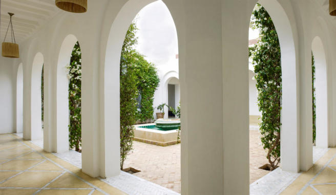 Moroccan style inner courtyard with covered passageways at Villa Jardin