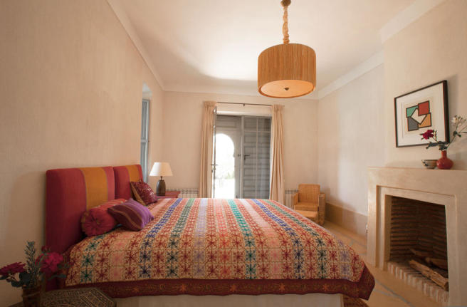 Guest bedroom with access to terrace at Villa Jardin