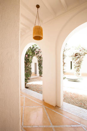 Corridor and archways onto inner courtyard at Villa Jardin