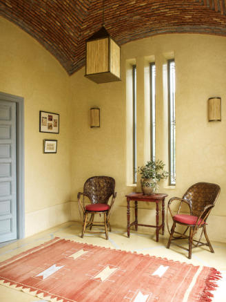 Entrance hall with brick ceiling and decorative chairs at Villa Jardin