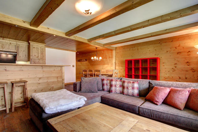 Sitting room with sofas and adjoining kitchen at Gai Torrent apartment in Verbier