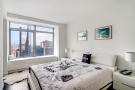 Double bedroom with city views at 123 Washington Street, Unit 36E
