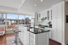 Kitchen with island and views of Brooklyn Bridge at at 440 Kent Avenue in New York