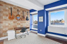 Guest bedroom with water and city views at 440 Kent Avenue in Brooklyn, New York