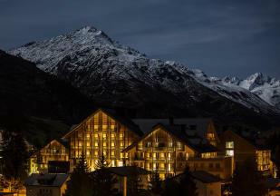Facade night mountains Andermatt Chedi Residences