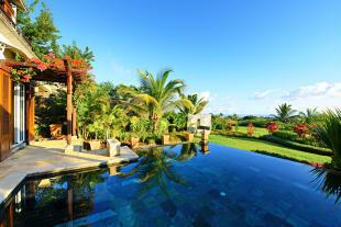 Infinity edge swimming pool rear facade Villas Valriche Mauritius