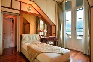 Bedroom wood floor ensuite balcony doors Villa on Lake Como The Lakes Italy