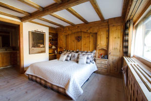 Bedroom wood floor master ensuite bathroom Chalet La Courtiliere Verbier