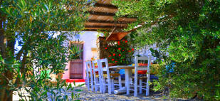 Outdoor dining area covered Lia Mykonos