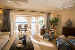 Living room stone floor sliding doors balcony Saint Peter's Bay