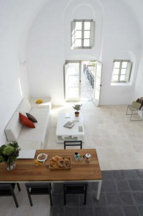 Dining area living open plan stone floor full height Villa Fabrica Santorini