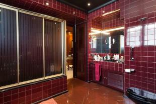 Bathroom red tiles marble shower The Penthouse Av de Pau Casals Barcelona