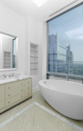 Bathroom bathtub bath marble large window Yorkville Avenue Canada