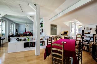 Open plan modern dining and living room wood floor Postel-Vinay Paris