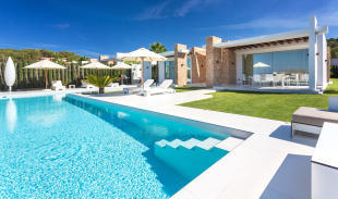 Large outdoor pool with garden at Villa Roberta in Ibiza